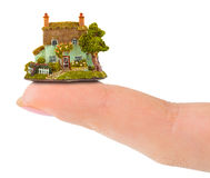 Finger and house Stock Photo