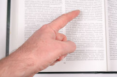 Finger hows an open book. Stock Photography