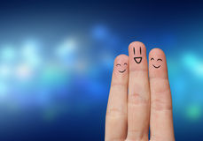 Finger hug. With Abstract Lights and painted smiley Royalty Free Stock Images