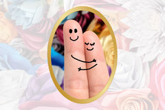 Finger hug. Against Roses Background Stock Photo