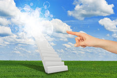 Finger indicates stairway to heaven. With clouds and sun. Concept background Royalty Free Stock Photo