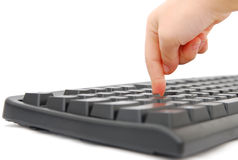 Finger and keyboard Stock Image