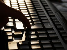 Finger on keyboard Stock Photo