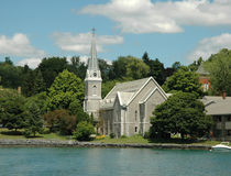 Finger Lakes Region: Lake Front Church and Steepl. Lake front Church with Steeple and clock tower. Skaneateles Lake, Finger Lakes Region, Upstate New York royalty free stock photos