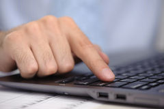 Finger with laptop computer Stock Images