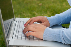 Finger Laptop typing outdoor Stock Photography