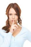 Finger on lips Stock Photos