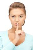 Finger on lips Stock Images