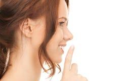 Finger on lips Stock Image