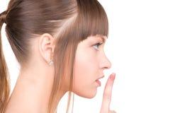 Finger on lips Stock Photo