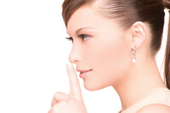 Finger on lips Stock Photography