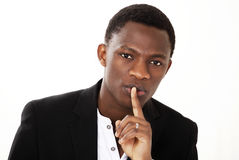 Finger on lips guy Royalty Free Stock Photography