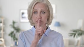 Finger on Lips by Old Woman. 4k high quality, 4k high quality stock video footage