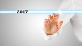 Finger of man touching line with year 2017 text Stock Photo