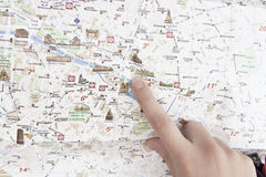 Finger in the map Royalty Free Stock Photography