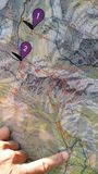 Finger on a map, closeup Royalty Free Stock Photos