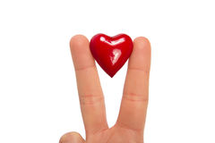Finger mit Herzen Goldfinger auf Himmelhintergrund Lizenzfreies Stockbild