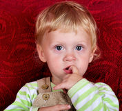 With finger in mouth Royalty Free Stock Photography