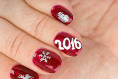Finger nail with christmas pattern Royalty Free Stock Photography