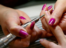 Finger nail polishing Stock Photos