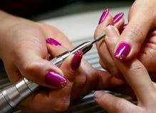 Finger nail polishing Stock Photos