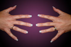 Finger nails. Hands spread showing false finger nails Royalty Free Stock Image