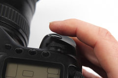 Finger is near the trigger button is digital camera close up Royalty Free Stock Photo