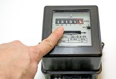 Finger and 13 number on the electricity meter Royalty Free Stock Photo