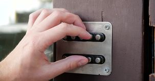 Finger opened door with door code. The action in the real time stock footage