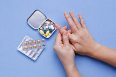 Finger pain with pills Royalty Free Stock Photography
