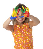 Finger Painting Girl. Studio photo of female child showing hands covered in finger paint Stock Photography