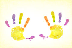 Finger Paints. Child's colorful handprint on textured background Royalty Free Stock Image