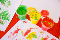 Finger paints in bright colors Stock Photos