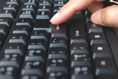 Finger of person touching computer  keyboard. Finger of person touching computer keyboard Stock Photos