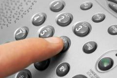 Finger and phone keypad. Business background Stock Photo