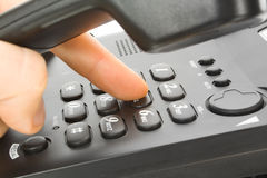 Finger with phone keypad royalty free stock photography
