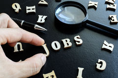 Finger pick a wood letters of jobs search Stock Photo