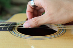 Finger picking the guitar Stock Image