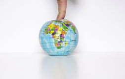 Finger on the planet Royalty Free Stock Photo