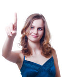 Finger point. Young girl with finger outstretched to point at something or to push a button stock image