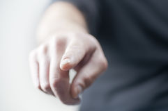 Finger pointing. A finger in the air pointing. Shallow depth of field Stock Photo