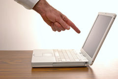 Finger pointing. Man pointing at an open laptop computer screen Royalty Free Stock Photo