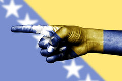 Finger pointing in Bosnia Herzegovina flag Royalty Free Stock Photography