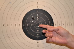 Finger pointing bullseye Royalty Free Stock Images
