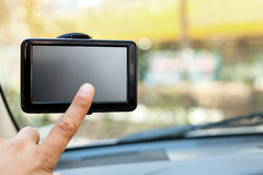 Finger pointing at car GPS Stock Images