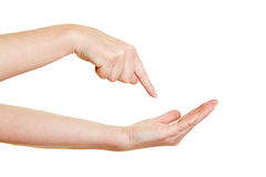 Finger pointing on empty palm Royalty Free Stock Photography