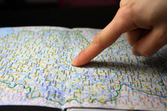 Finger pointing destination target on map. Finger pointing destination target on the car map Royalty Free Stock Image