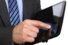 Finger pointing on digital tablet Royalty Free Stock Image