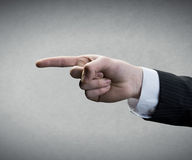 Finger pointing. On gray background Royalty Free Stock Photo
