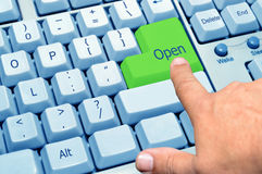Finger pointing at the green key open Royalty Free Stock Image